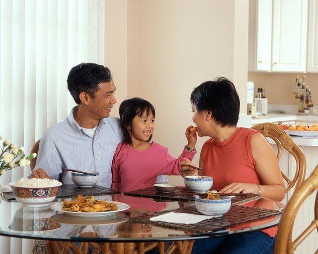 Asian family eating dinner together